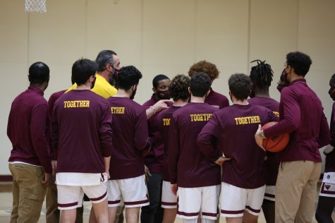 Men's basketball team huddles up before their game against DePauw University on January 25th. (Photo Credits/Justin Bjorseth)