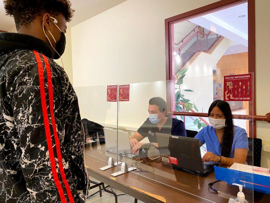 Stefan Kovacevic, M.D, and Tylar Pon, R.N., check in students in CC 200 for their on-campus COVID test on Thursday January 28th, 2021.