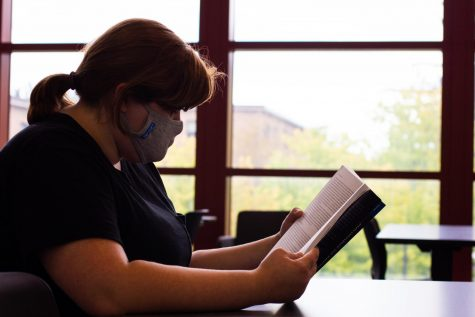 A CUC student reads at the new CULearn Teaching and Learning Commons in the Christopher Center.