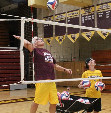 Coach Katarzynski participating in team drills during CUC Mens Volleyball practice on September 27th.